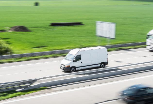 White van driving on raod